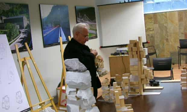 World-weary … Frank Gehry inspects a range of models before his presentation to the jury.