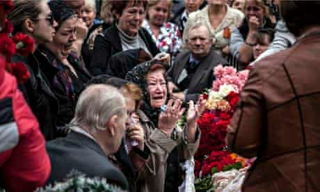 Relatives mourn a pro-Russia medical worker shot dead by Ukranian troops