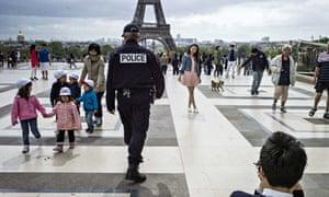 A policeman patrols on Trocadero Square