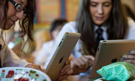 Schoolgirls using iPad