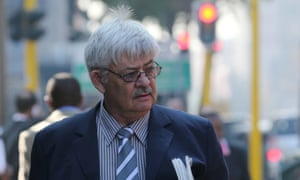 """Tom """"Wollie"""" Wolmarans, a retired South African Police Service forensics expert, arrives to give evidence in the Oscar Pistorius trial at the high court in Pretoria on Thursday."""