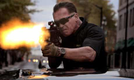 Arnie's back in action for Sabotage … but we can't tell whether he's enjoying it from his facial exp