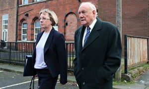 Former broadcaster Stuart Hall with a member of his legal team outside Preston crown court