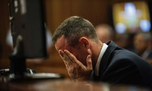 Oscar Pistorius listens to evidence at the high court in Pretoria on Thursday.