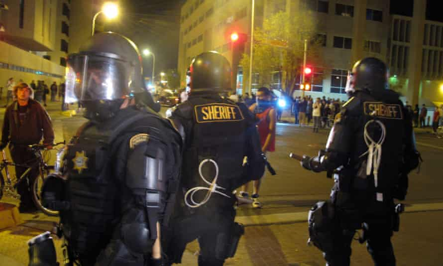 in March, riot police stood by a crowd protesting police shootings in Albuquerque.