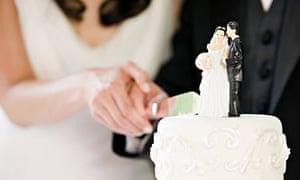 Newlyweds cutting a wedding cake