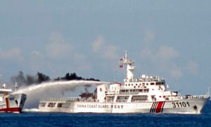 A Chinese ship uses water cannon on a Vietnamese ship in the South China Sea