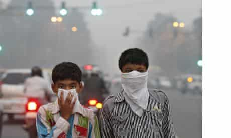 Children protect their faces from Delhi's smog.