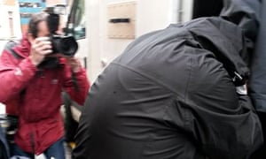Robert Riley is taken from court after being jailed for offensive tweets about Ann Maguire's killing