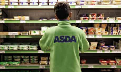 Asda employee fills shelves