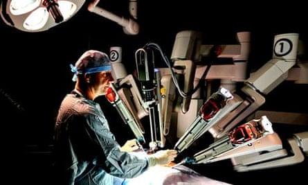 Staff using the Da Vinci robot at Freeman hospital