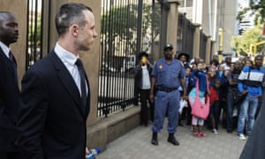 People wait outside the high court in Pretoria as Oscar Pistorius leaves following a hearing on Thursday.
