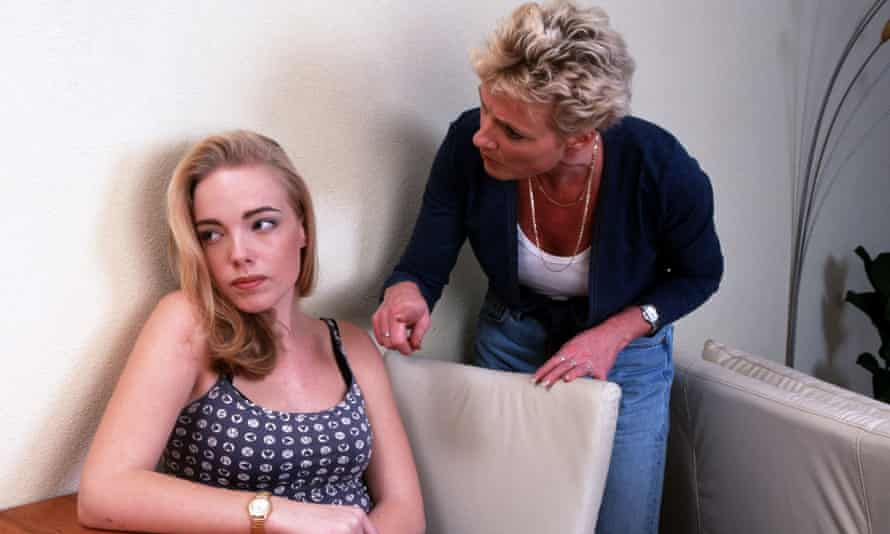 Blonde Teenage girl being criticised by mother