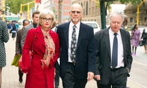 Arnold Pistorius, centre, and Lois Pistorius arrive at the high court on Tuesday.