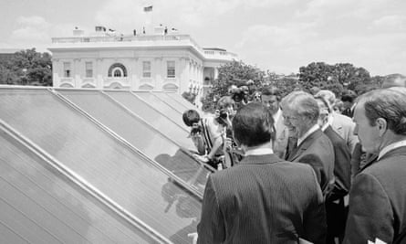 In this June 20, 1979, file photo President Jimmy Carter, center, is surrounded by reporters and photographers as he inspected new White House solar hot water heating system located on the roof of the West Wing of the mansion, over the Cabinet Room. The Obama White House will announce Tuesday, Oct. 5, 2010, that the most famous residence in America plans to install solar panels for the first time atop the White House's living quarters. The solar panels _ which will be installed by spring 2011 _ will heat water and supply some of the first family's electricity.