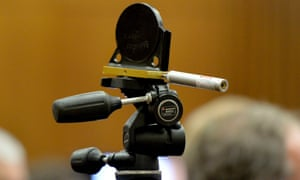 A laser is used to demonstrate the path of one of the bullets during testimony by the defence on Friday.