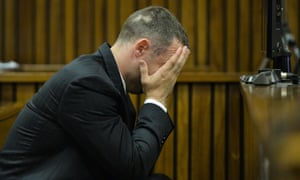 Oscar Pistorius cradles his head in his hands as he listens to evidence in court on Friday.