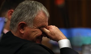 Oscar Pistorius' lawyer Barry Roux covers his eyes during the testimony of defence ballistics expert Tom Wolmarans on Friday.