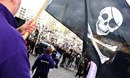 A supporter of filesharing hub The Pirate Bay, waves a Jolly Roger flag during a demo in Sweden