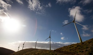 Wind turbines are pictured near the upper reservoir of the Gorona power station Canary island of El Hierro on March 28, 2014