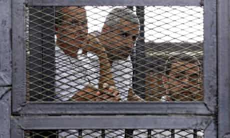 Al-Jazeera journalists Peter Greste, Mohamed Fahmy and Baher Mohamed in court in Cairo