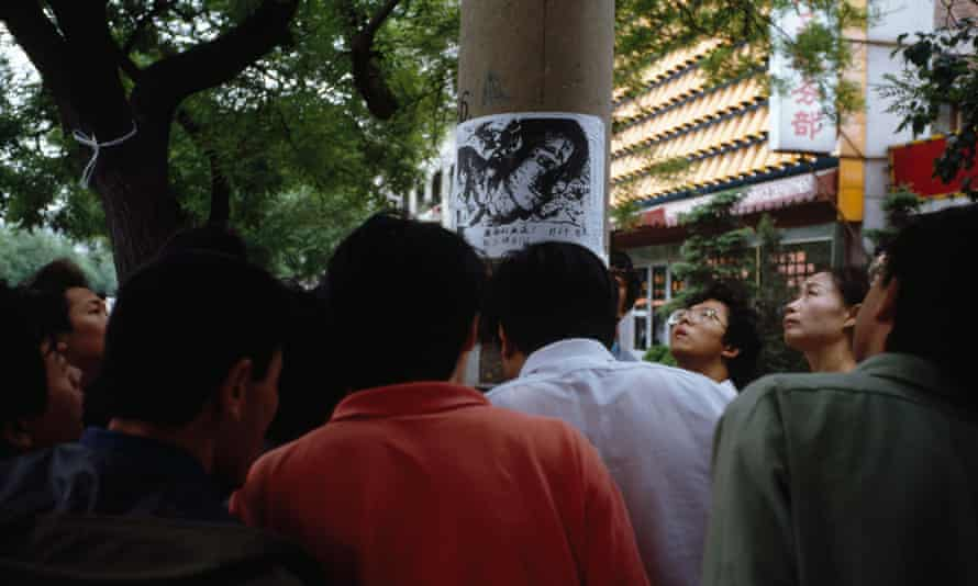 Posters put up on lampposts showing images from the massacre printed at university presses.