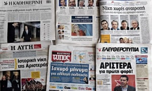 Greek newspapers are on display in Athen