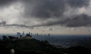 Griffith Observatory stands as clouds gather above the skyline of downtown Los Angeles, California, U.S., on Feruary. 27, 2014. Forecasters are saying that a storm dumping light to moderate rain across Los Angeles County is moving faster than expected, which could mean an extended break before a more powerful system arrives.