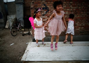 e-waste from the agencies: Children play on abandoned wood panels