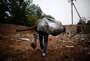 e-waste from the agencies: A garbage collector carries a sack of of items