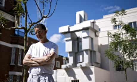 Antony Gormley in front of his new work, Room at the new Beaumont hotel