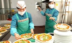 North Koreans make pizza at an Italian restaurant in Pyongyang.