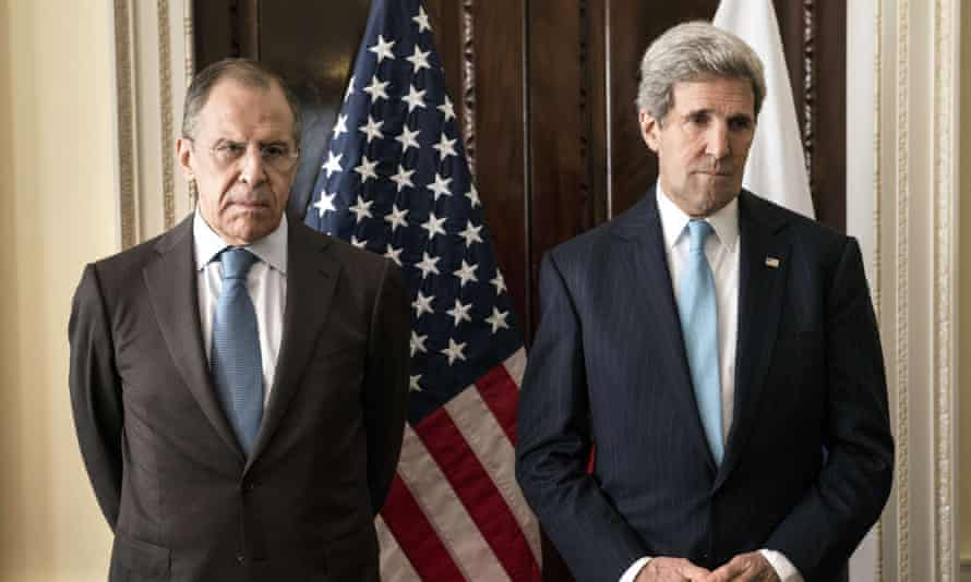Russian Foreign Minister Sergey Lavrov (L) and US Secretary of State John Kerry stand together before talks on Crimea in March 2014.