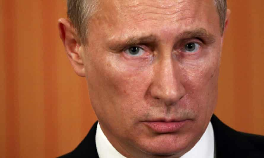 Russian President Vladimir Putin talks to the media in June 2014.