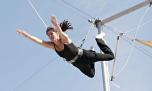 A trapeze student at a class in New York