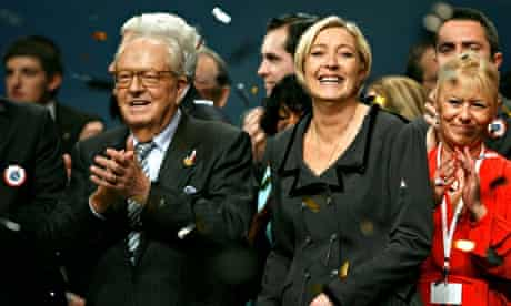 Marine Le Pen (centre) and her father Jean-Marie (left)