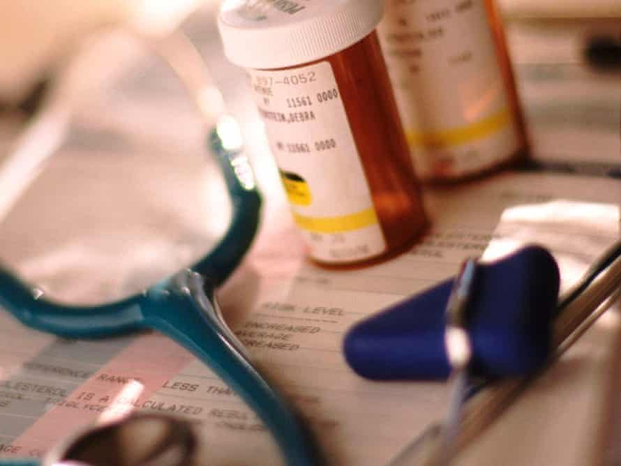 A stethoscope and pills.