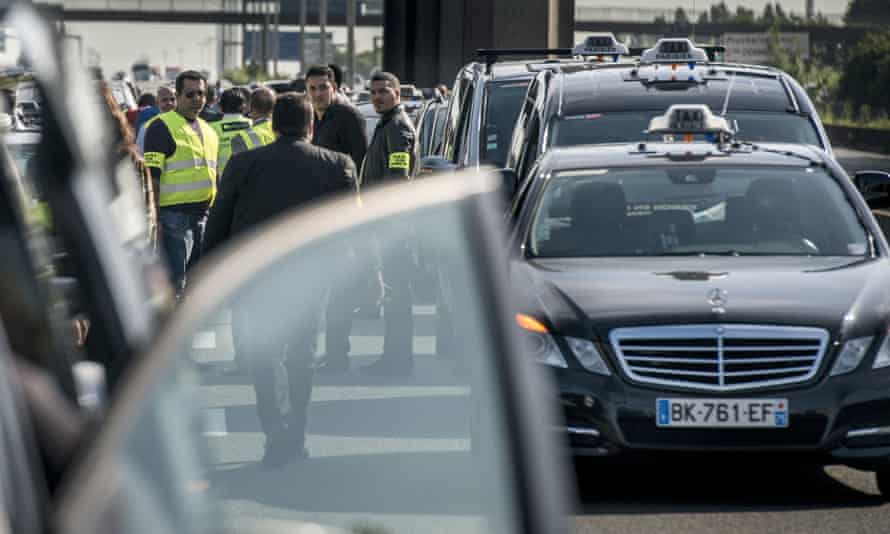 Taxis drivers block highway outside Paris as they take part in a demonstration against Uber on June 11.