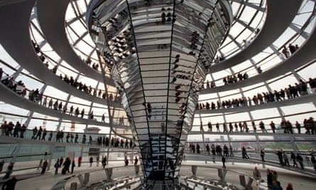 Visitors crowd the glass-dome of the Reichstag-Building in Berlin