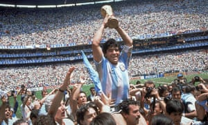 Diego Maradona lifts the World Cup trophy for Argentina in 1986. Photograph: Carlo Fumagalli/AP