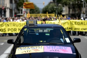 A taxi leads demonstrators during strike action in Barcelona.