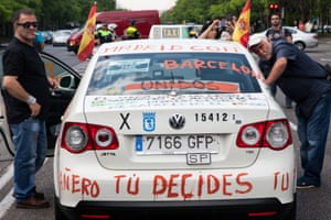 A taxi covered in messages against online transport companies at the protest against the Uber app in Madrid, Spain.