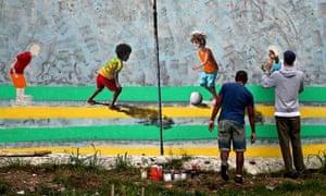 A Brazilian artist paints a mural near the Corinthians club ground, in Sao Paulo.