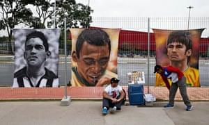 Posters of Brazilain legends Garrincha, Pele and Neymar outside the World Cup stadium, Sao Paolo