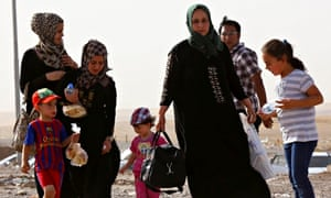 A family fleeing the violence in Mosul
