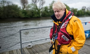 The Mayor of London Boris Johnson meets RNLI Lifeboat crews at Chiswick Lifeboat Station in west London where he also took the wheel of one of their boats on the river Thames during the RNLI's national fund raising week.