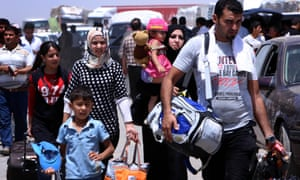 Iraqi families fleeing violence in the northern Nineveh province gather at a Kurdish checkpoint in Aski kalak, 40 kms West of Arbil, in the autonomous Kurdistan region, on June 10, 2014. Suspected jihadists seized Iraq's entire northern province of Nineveh and its capital Mosul, the country's second-largest city, in a major blow to authorities, who appear incapable of stopping militant advances.