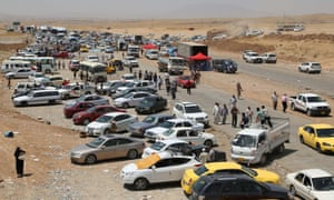 Thousands flee Iraq's Mosul due to the clashes between security forces and militants of Islamic State of Iraq and the Levant in Arbil, Iraq on June 11, 2014