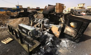 Burnt vehicles belonging to Iraqi security forces are pictured at a checkpoint in east Mosul, one day after radical Sunni Muslim insurgents seized control of the city, June 11, 2014.