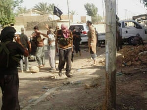 Militias of the al-Qaida breakaway group Islamic State of Iraq and Syria deploy in an area in Tikrit, 80 miles north of Baghdad, Iraq,